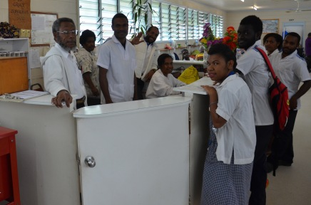 Shift change at the nurses station with the nurses and nursing students preparing for the day.